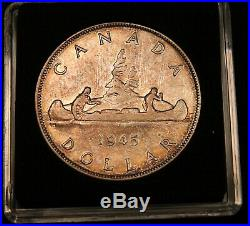 1945 Canada Silver Dollar. Rare date. Nicely toned Coin